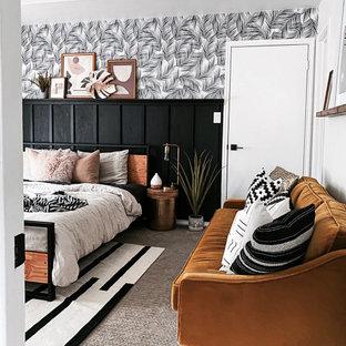 Ejemplo de habitación de invitados moderna, de tamaño medio, sin chimenea, con paredes blancas, moqueta y suelo beige