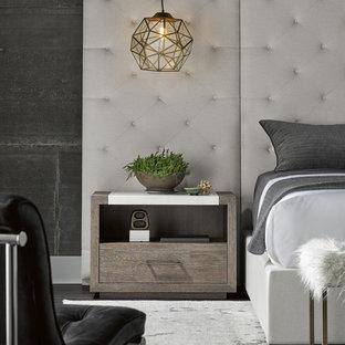 Design ideas for a modern bedroom in Houston with grey walls, dark hardwood floors and brown floor.