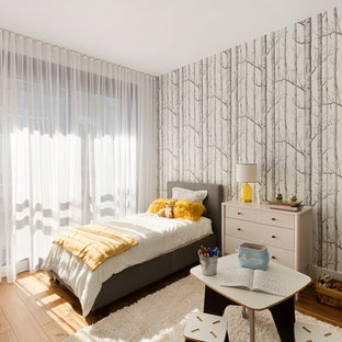 Design ideas for a mid-sized scandinavian guest bedroom in New York with multi-coloured walls, medium hardwood floors and yellow floor.