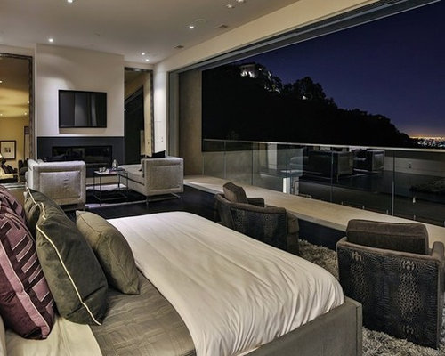 Example Of A Large Minimalist Master Carpeted Bedroom Design In Los Angeles  With White Walls,