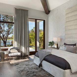 Bedroom - large modern dark wood floor and brown floor bedroom idea in Miami with gray walls