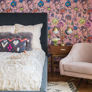 Inspiration for an eclectic medium tone wood floor bedroom remodel in Albuquerque with multicolored walls