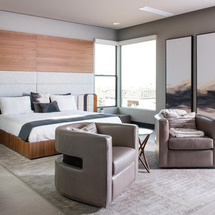 Photo of a large contemporary master bedroom in Las Vegas with brown walls, porcelain floors and grey floor.