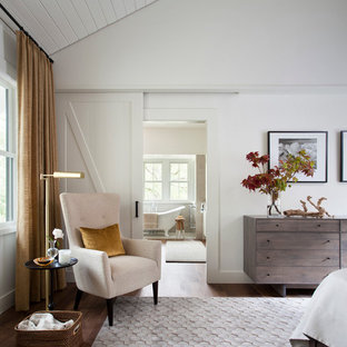 Country bedroom in Austin with white walls.