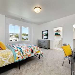 Example of a large country carpeted and beige floor bedroom design in Boise with white walls and no fireplace
