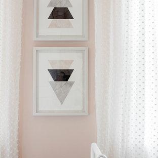 Bedroom - mid-sized farmhouse guest dark wood floor and brown floor bedroom idea in DC Metro with pink walls