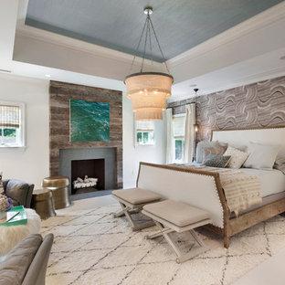 На фото: с высоким бюджетом хозяйские спальни среднего размера в стиле современная классика с разноцветными стенами, стандартным камином, деревянным полом и фасадом камина из дерева