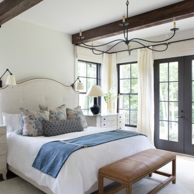 Example of a large country master light wood floor and beige floor bedroom design in Atlanta with white walls and no fireplace
