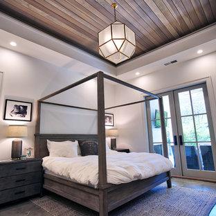 Ejemplo de dormitorio principal, moderno, de tamaño medio, con paredes blancas, suelo de cemento y suelo gris