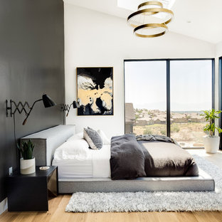 Inspiration for a large transitional master light wood floor and beige floor bedroom remodel in Salt Lake City with black walls