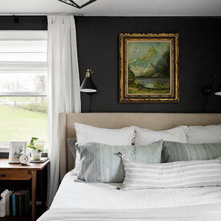 Inspiration for a transitional medium tone wood floor and brown floor bedroom remodel in Nashville with gray walls