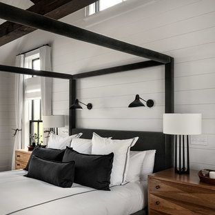 Design ideas for a large country master bedroom in New York with white walls, dark hardwood floors and brown floor.