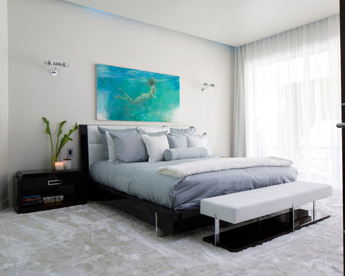 example of a trendy master bedroom design in orlando with gray walls and carpet