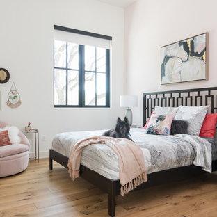 Country light wood floor and beige floor bedroom photo in Austin with pink walls