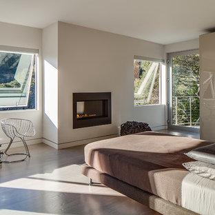 Esempio di una camera da letto minimalista con pareti bianche e camino lineare Ribbon