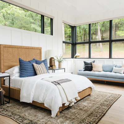 Large transitional guest light wood floor and beige floor bedroom photo in Salt Lake City with white walls
