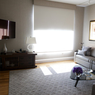 Mid-sized minimalist guest light wood floor bedroom photo in Los Angeles with gray walls and no fireplace