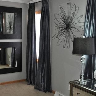 Imagen de dormitorio tipo loft, moderno, de tamaño medio, sin chimenea, con paredes grises, moqueta y suelo gris