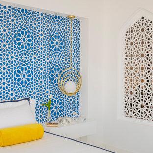 На фото: большая хозяйская спальня в стиле модернизм с белыми стенами, мраморным полом, подвесным камином, фасадом камина из дерева и белым полом с