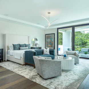 Contemporary bedroom in Miami with grey walls, dark hardwood floors and brown floor.