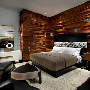 Inspiration for a large modern master bedroom in Sacramento with brown walls, painted wood floors, a two-sided fireplace, a stone fireplace surround and black floor.