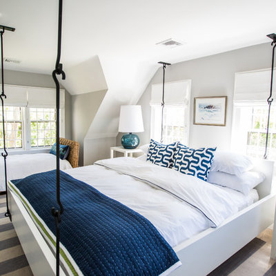 Beach style bedroom photo in Boston with gray walls
