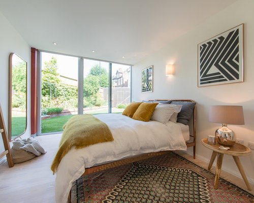 Photo Of A Contemporary And Modern Bedroom In London With White Walls And  Beige Floors.