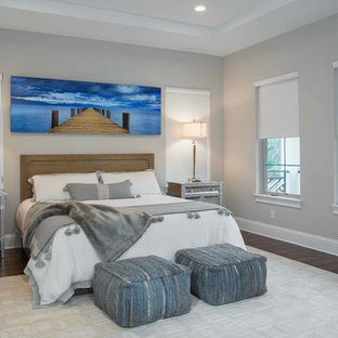 Bedroom - large transitional master medium tone wood floor and green floor bedroom idea in Tampa with gray walls and no fireplace