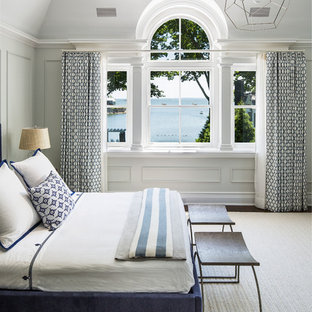Bedroom - large beach style master dark wood floor and brown floor bedroom idea in New York with white walls and no fireplace
