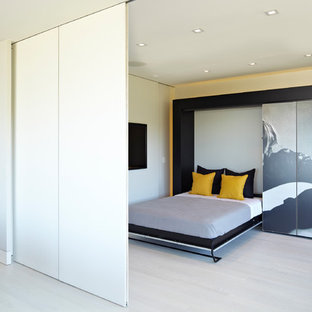 Example Of A Mid Sized Trendy Guest Light Wood Floor And Beige Floor  Bedroom Design