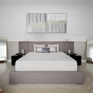 На фото: хозяйская спальня среднего размера в стиле модернизм с белыми стенами, полом из керамогранита и разноцветным полом с