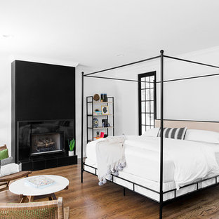 Inspiration for a medium sized classic master bedroom in Dallas with white walls, medium hardwood flooring, a tiled fireplace surround, brown floors and a ribbon fireplace.