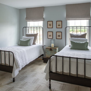 Bedroom - mid-sized country guest medium tone wood floor and brown floor bedroom idea in DC Metro with blue walls