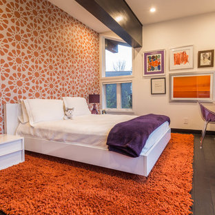 Inspiration for a mid-sized contemporary guest bedroom in New York with orange walls, dark hardwood floors and no fireplace.