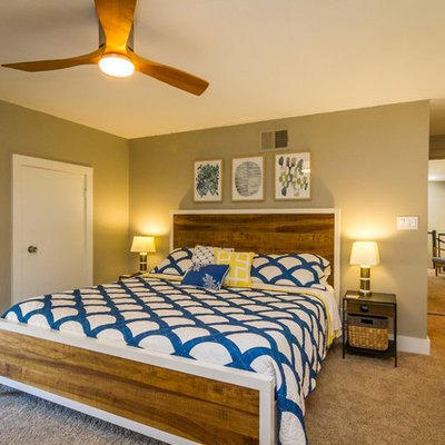 Island style master carpeted and brown floor bedroom photo in Hawaii with brown walls