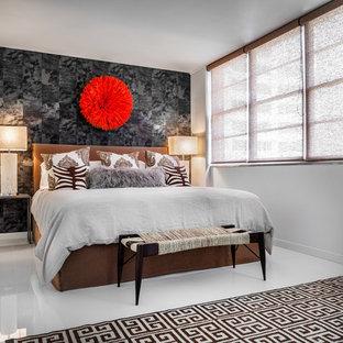 Bedroom - contemporary master porcelain floor bedroom idea in Miami with white walls
