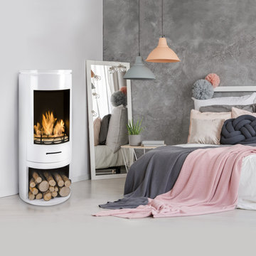 Modern White Cylinder Stove in a stylish bedroom setting