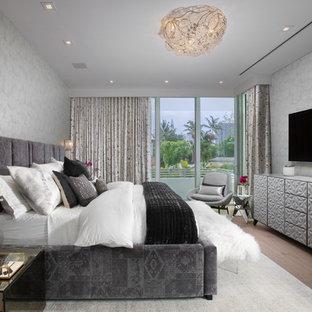 Bedroom - eclectic master medium tone wood floor and brown floor bedroom idea in Miami with gray walls