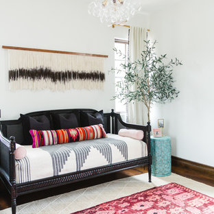 Inspiration for a large eclectic guest dark wood floor and brown floor bedroom remodel in San Diego with white walls and no fireplace