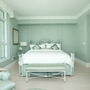 Mid-sized transitional master light wood floor and gray floor bedroom photo in San Francisco with green walls
