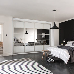 Medium sized contemporary guest bedroom in West Midlands with white walls, dark hardwood flooring and black floors.