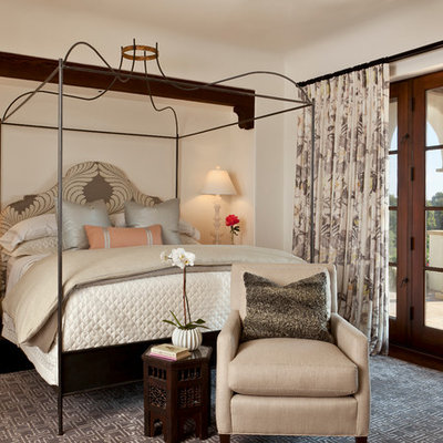 Example of a mid-sized tuscan guest dark wood floor bedroom design in Santa Barbara with beige walls and no fireplace