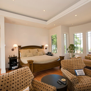 Example of a mid-sized eclectic master bamboo floor bedroom design in San Francisco with gray walls