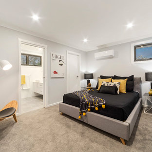 Contemporary master bedroom in Melbourne with grey walls, carpet and beige floor.