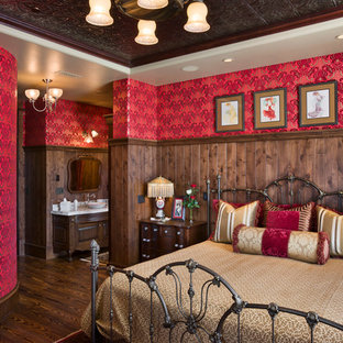 This is an example of a country master bedroom in Other with red walls, dark hardwood floors and no fireplace.