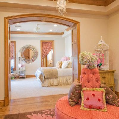 Bedroom - mediterranean medium tone wood floor bedroom idea in Las Vegas with beige walls