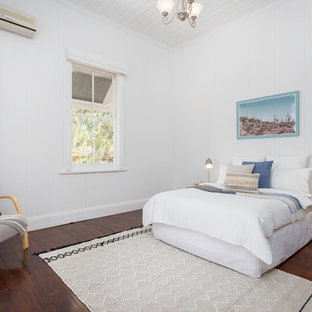 Inspiration for a scandinavian bedroom in Brisbane with white walls, dark hardwood floors and brown floor.