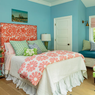Design ideas for a mid-sized country guest bedroom in Los Angeles with blue walls, light hardwood floors and beige floor.