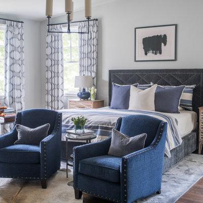 Large transitional master medium tone wood floor and brown floor bedroom photo in Atlanta with gray walls