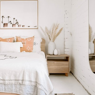 Inspiration for a large mediterranean bedroom in Sunshine Coast with white walls and white floor.
